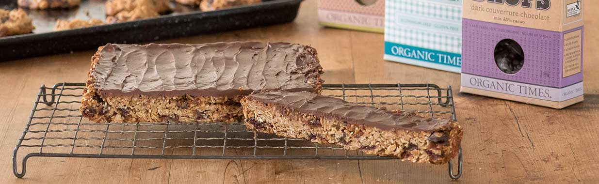 Tray of sesame chocolate tahini bars with Organic Times baking ingredients