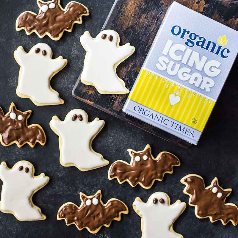 Organic Times Icing Sugar next to a tray of Halloween ghost and bat cookies