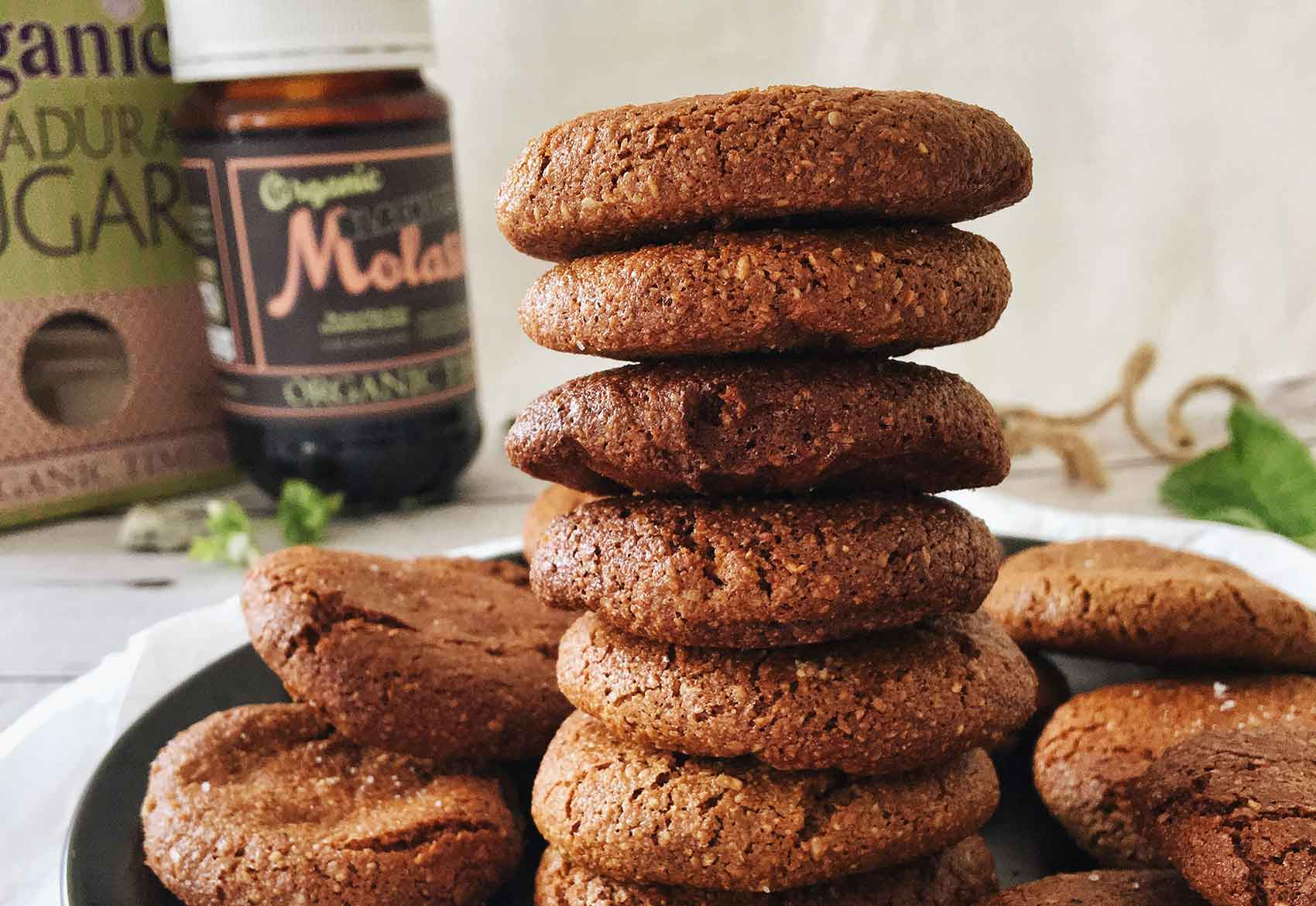 a stack of healthy molasses ginger cookies with organic times pantry products