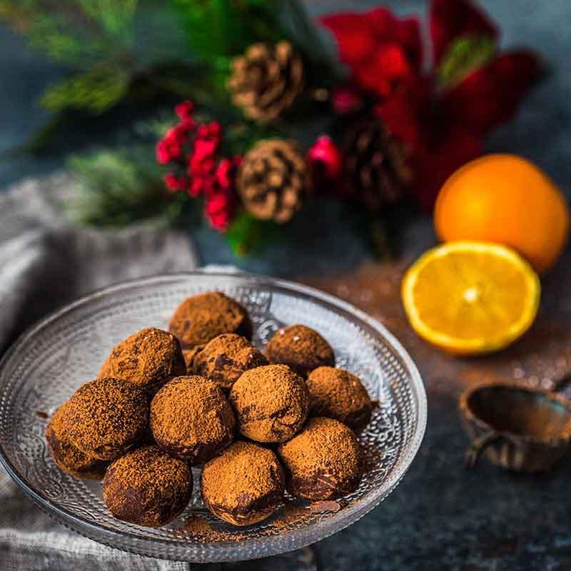 a plate of Christmas orange truffles