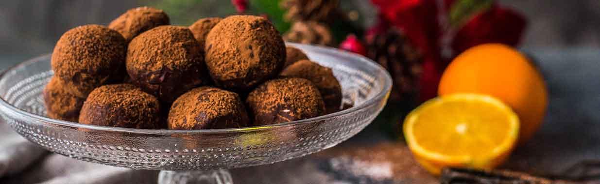 a plate of Christmas organic orange truffles