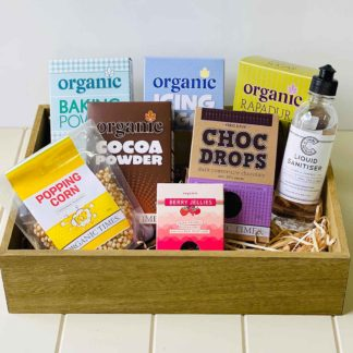 an organic times vegan gift set that includes food items and hand sanitiser